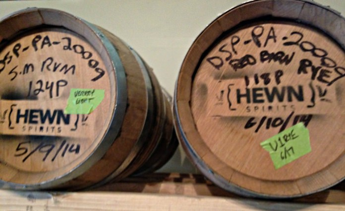 Barrels of rum and rye at Hewn Spirits. Photo credit Lynne Goldman
