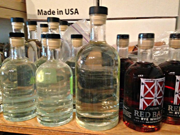 Distillate and rye on the shelf at Hewn Spirits; photo credit Lynne Goldman