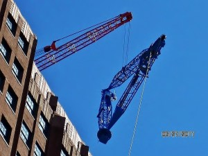 A slideshow of the Master Riggers at Budco rigging a second derrick onto the roof 32 Avenue of the Americas using our existing derrick.