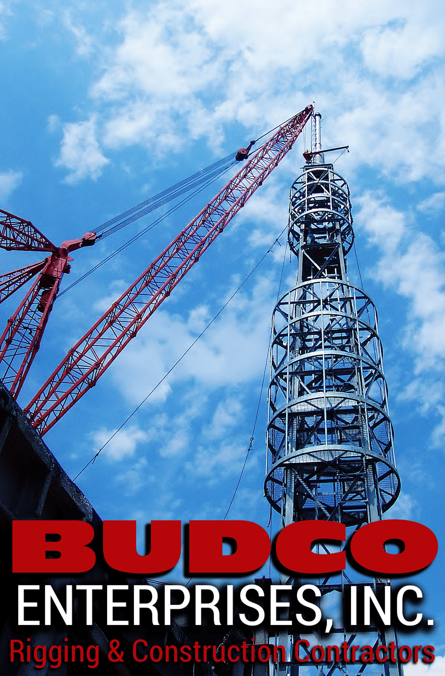 The Master Riggers at BUDCO erecting a cell tower on a high rise roof in NYC with a derrick