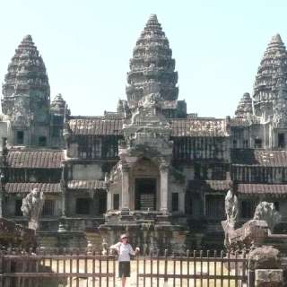 "Anasha at the back view of Angkor Wat... In the 1800's the ruins of an ancient and very enlightened civilization was discovered, and many ""living Buddhas"" were teaching there"