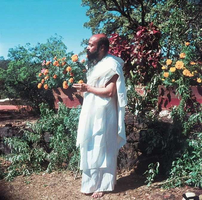 "a young, vibrant Osho ""earthing"" and enjoying in the garden"