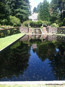 Reflecting pool surrounded by flower gardens, Lewis & Clark College.
