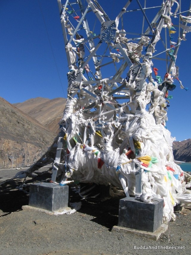 Prayer flags on transmission tower