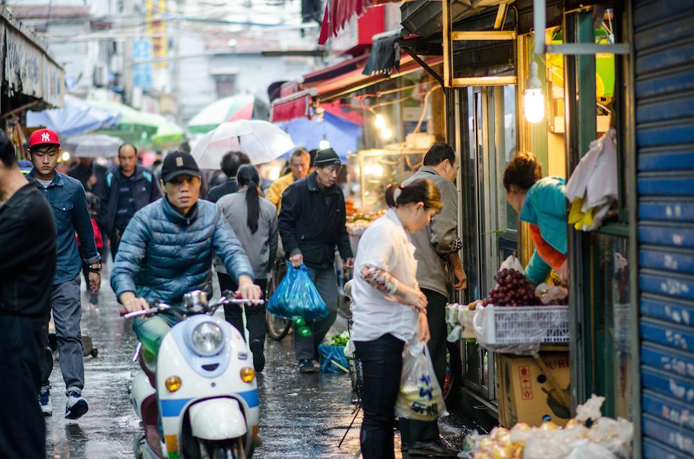 Shanghai-back-alleys-China-shopping-umbrellas-rainy-day-Jenny-Adams-travel-Buddha-drinks-fanta-5081