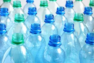 Many empty blue and green water bottles. Shallow DOF.