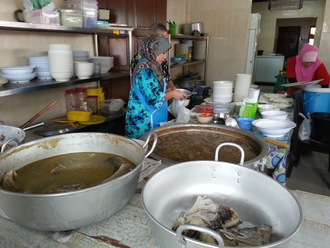 THE PRECOOKED FISH HEAD AND BIG SOUP POT