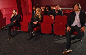 New Ghost - photo of band members sitting in cinema