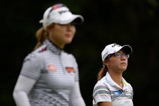 Lydia Ko and Meena Lee walk off 9 tee (Small)