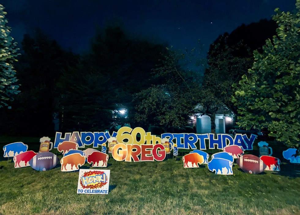 Happy Birthday Yard Sign with flock of Buffalo in Amherst, New York
