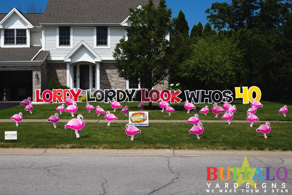 Flamingo Flock with birthday yard sign from Buffalo Yard Signs