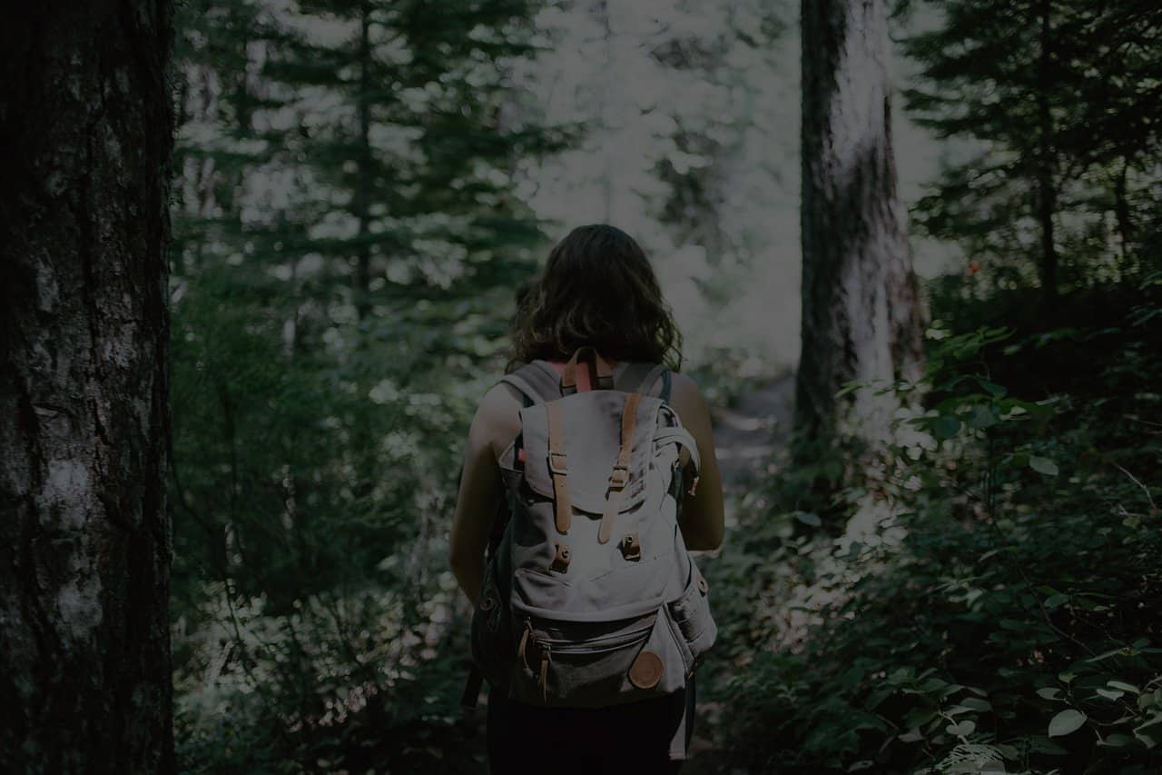hiker in the woods with backpack