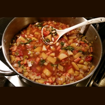 Soup's On... acorn squash, mustard greens, carrots, white beans, leeks, and onions