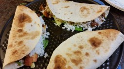 Grilled tostadas stuffed with spinach, rice, madras lentils, fresh peaches, and raw zucchini