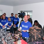 Inside the Sammons house as the home is dedicated and the keys are handed over from the sponsor to the partner family.