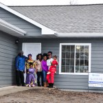 Pictured is the partner family in front of their finished home that was sponsored by Sammons Financial.