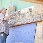 Applying stone finish to the exterior
