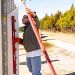 Adjusting bracing to make the wall plumb and level