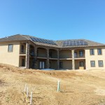 Back of house with solar panels