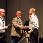 Alfonso Nieves (BuildBlock) and Joel Johns (Green Built) accept award