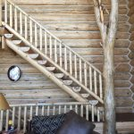 Log staircase and interior tree