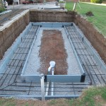 Gravel, steel, and plumbing is installed in footer.