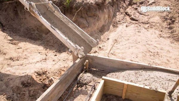 Place concrete in formwork. Care should be taken when consolidating concrete to eliminate  voids or honeycombing.