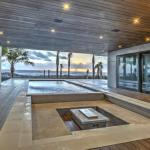 Partially covered pool overlooking beach