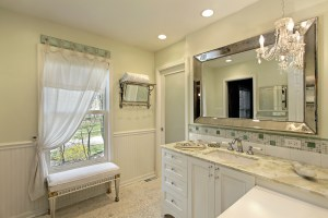 Bathroom in luxury home with white cabinetry