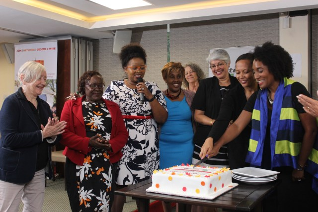 All the winners from the various categories cut a commemorative cake with the WIRE leadership.
