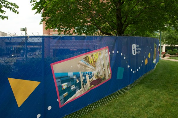 The eye-catching fence wraps around the construction site from Perkins Square Park to Exchange Street
