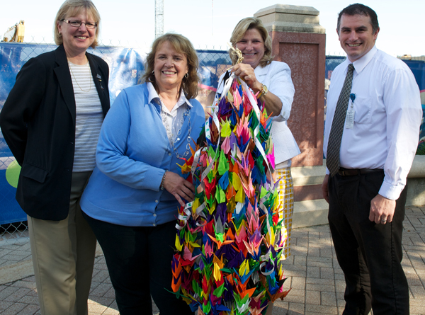 Over the past year, Akron Children's construction team folded 1,000 origami cranes to signify hope and community. The cranes will be displayed at Peace Memorial Park in Hiroshima. Pictured L-R: Marge Zezulewicz of Hasenstab Architects; Sherry Valentine, an Akron Children's deployment leader; Grace Wakulchik, COO; and Scott Radcliff of Hasenstab Architects.