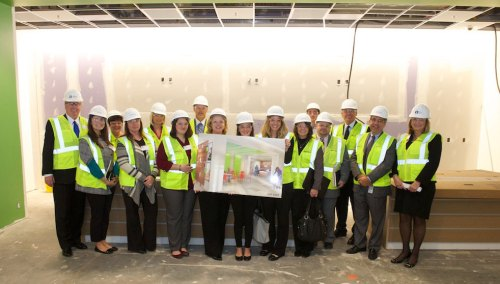 Kay team members toured the new building stopped at the site of the upcoming Kay Kafé.