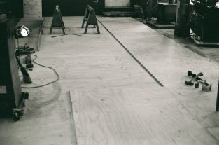 "The concrete slab was leveled with grout. Then two layers of 3/4"" T&G plywood were applied"