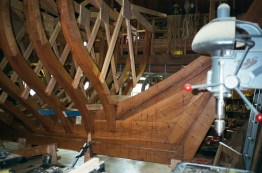 "The frames near the bow and stern get a ""strongback"" which ties the two frame halves together and to the deadwood"