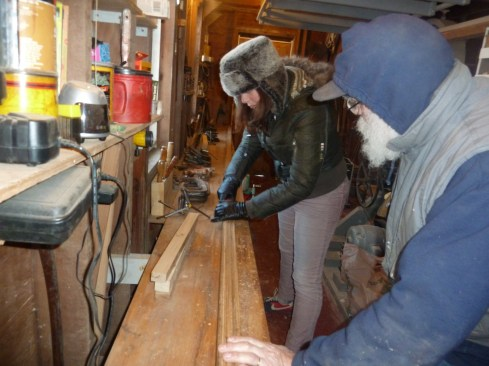 Mandi scrapes glue in preparation for planing the long batten
