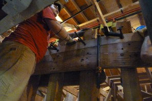 Josh finishes clamping the top cuddy deck plank.
