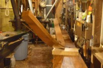 Starboard aft plank getting a coat of linseed oil and turpentine before fastening.