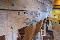 Ten 3 inch #24 wood screws in each butt joint, backed with a 2 1/4 inch thick butt block behind the planks and between the frames.