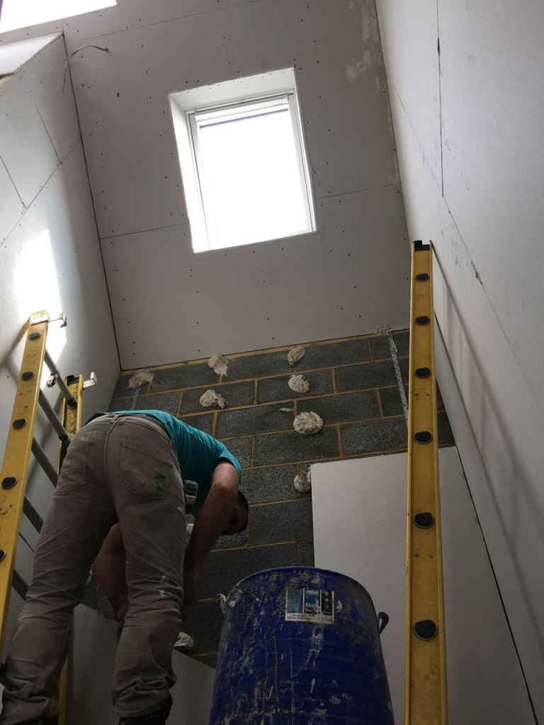 Dot and dab plasterboard application in stairwell