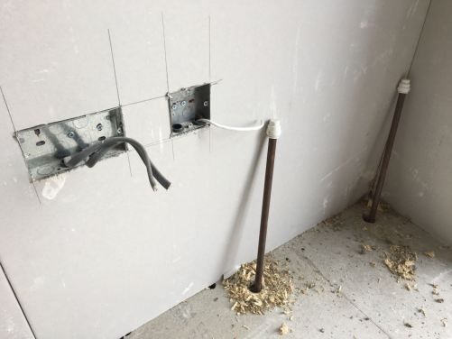 Plasterboard cut for sockets and plumbing