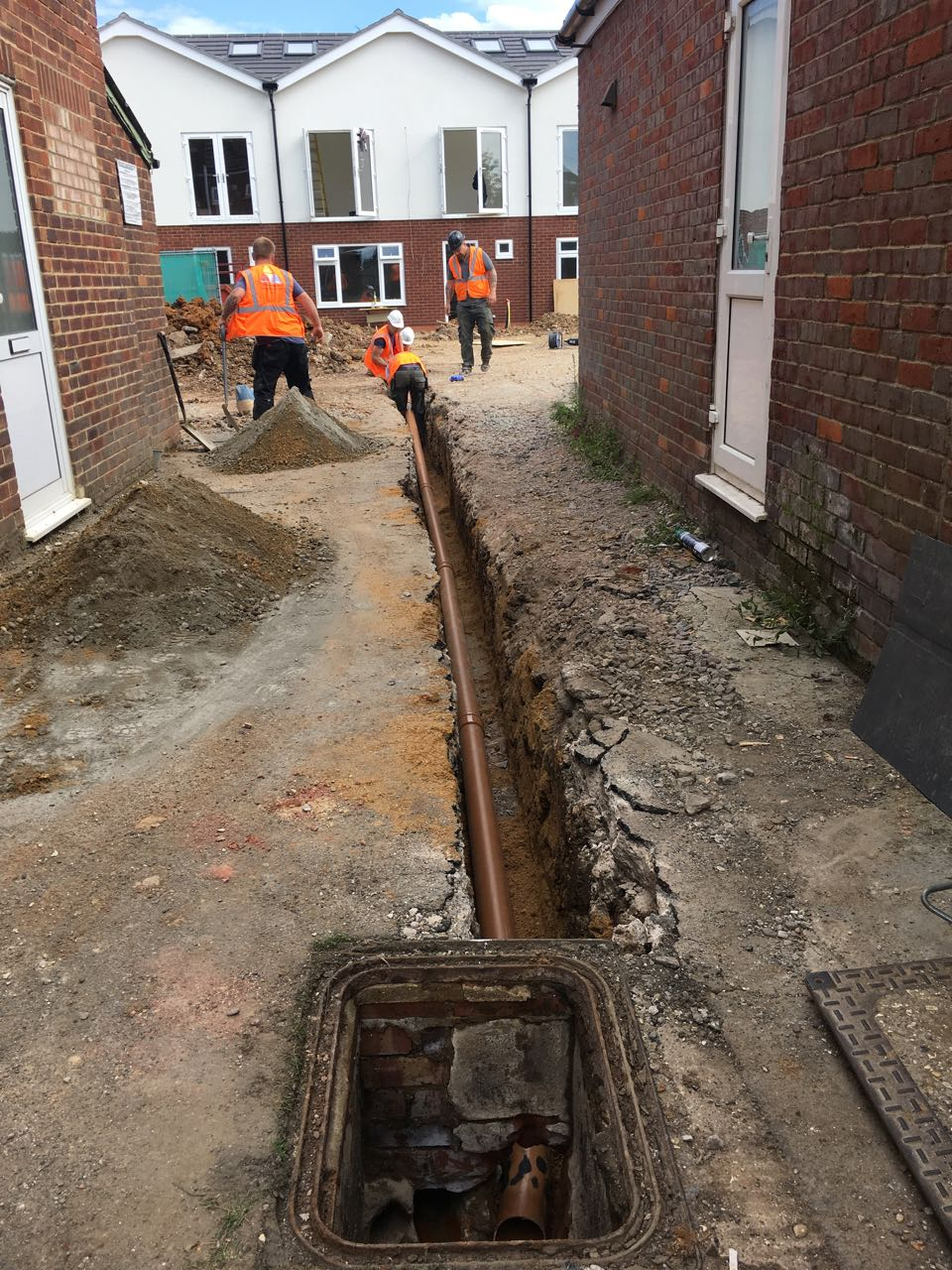 Drainage pipe run from indirect connection to houses