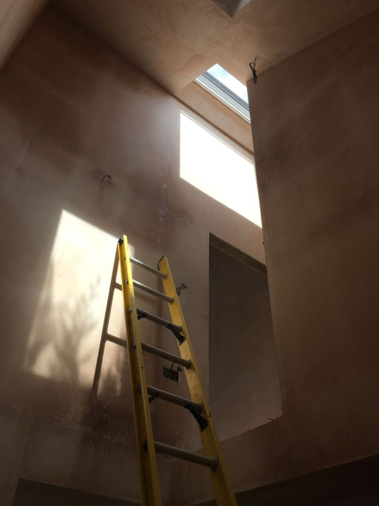 Stairwell plaster skimmed with shadows