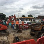 Digging trench for utility services by public boundary
