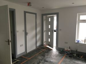 Grey skirting and architraves and white walls