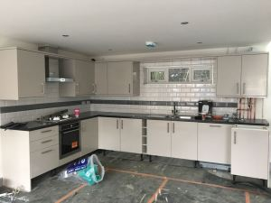 Kitchen white Metro tiles with grey stripe