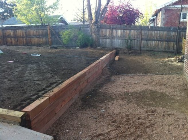 New retaining wall and french drain to prevent flooding