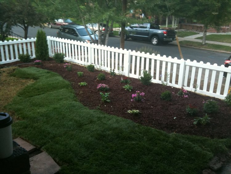 New flower beds and white picket fence to increase curb appeal