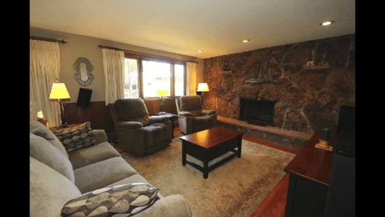 Family room with rock wall fireplace