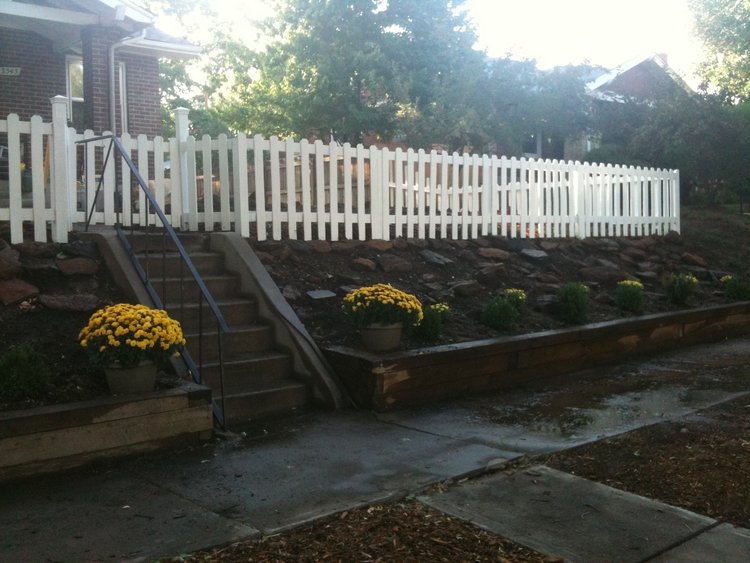 The white picket fence adds curb appeal to this home